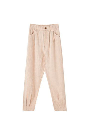 Rustic trousers with pleated hems