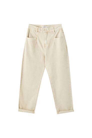 Double-button ochre jeans