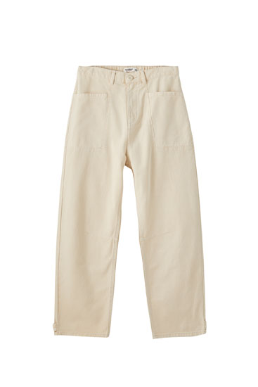 Posede jeans med påsyede lommer