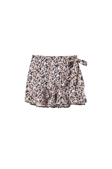 Shorts estampados volantes