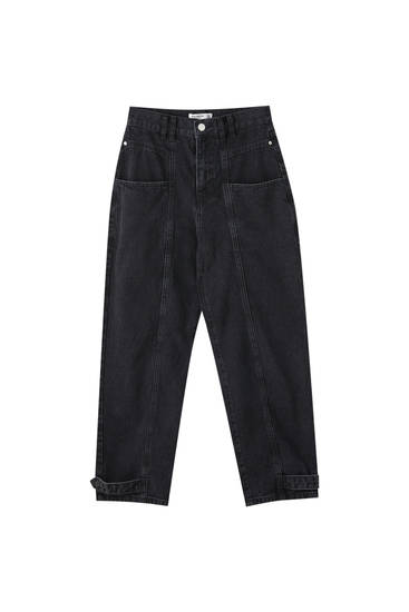 Черные джинсы свободного кроя с защипами и кокеткой