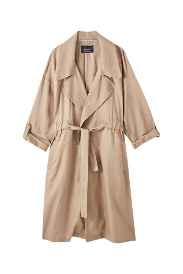 Gabardina trench fluida detalle resorte