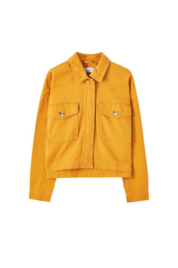 Orangefarbene Jeansjacke mit Reißverschluss