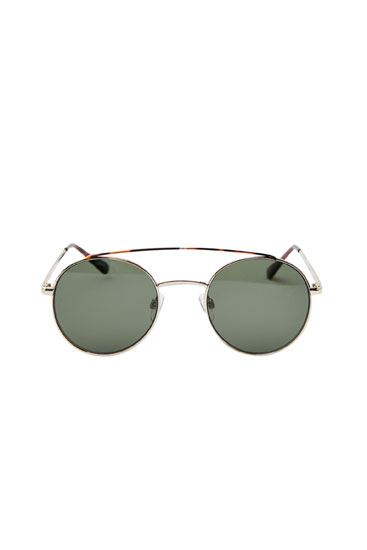 Oval sunglasses with a tortoiseshell bridge