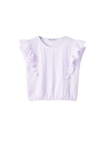 Ruffled top with elastic hem
