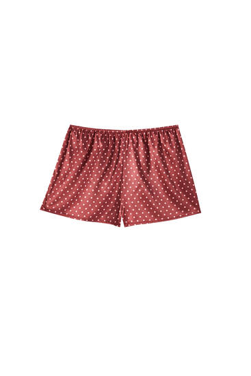 Lace-trimmed shorts with polka dots