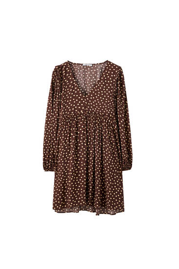 Polka dot dress with ruffled sleeves