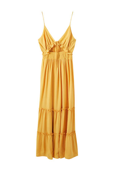 Long mustard-yellow dress with cut out detail