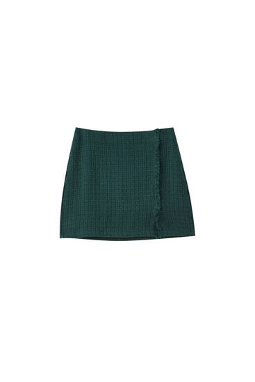 Mini skirt with vents and frayed detail