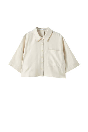 Flowing shirt with front pockets