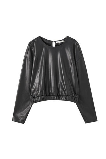 Faux leather top with an elastic hem
