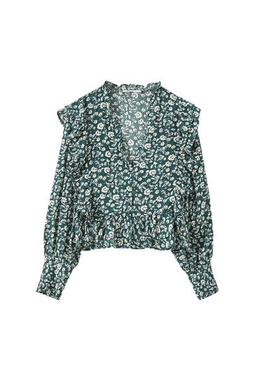 Printed green blouse with ruffles