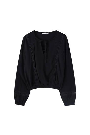 Black blouse with lace trims