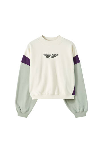 White sweatshirt with contrast panels