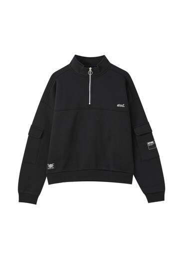 Black sweatshirt with an embroidered label