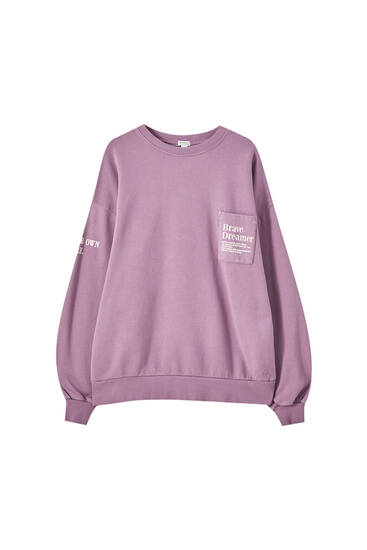 Mauve sweatshirt with graphic and pocket