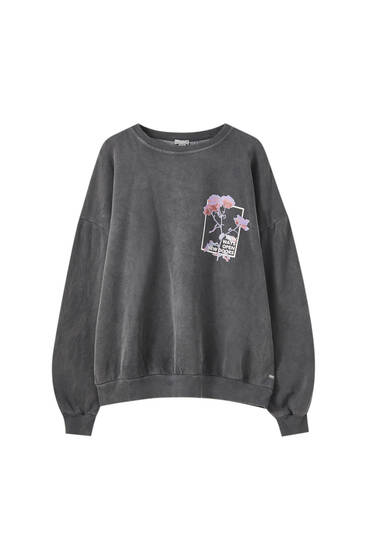 Faded black sweatshirt with roses
