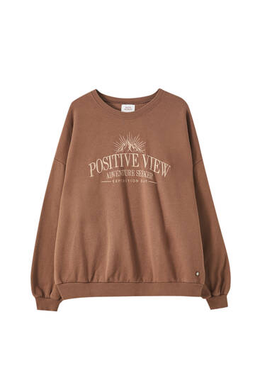 Brown sweatshirt with embroidered slogan
