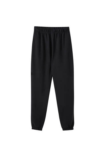 Jogging trousers with elastic hems