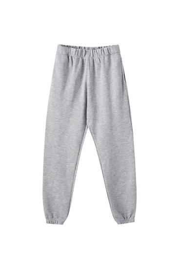 Joggingbukser med elastik i buksebenskanterne
