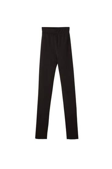 Black trousers with slit