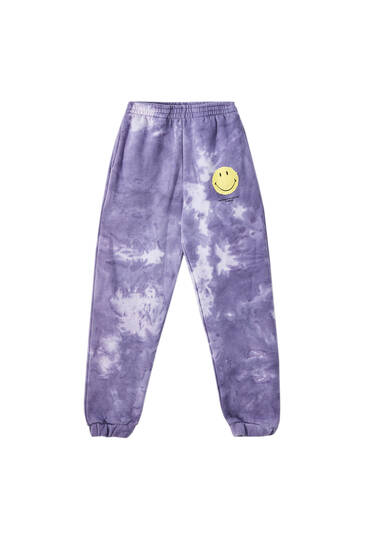 Lilac smiley face tie-dye jogging trousers