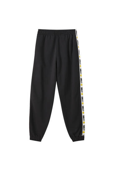 Pantalon jogger noir Smiley bandes