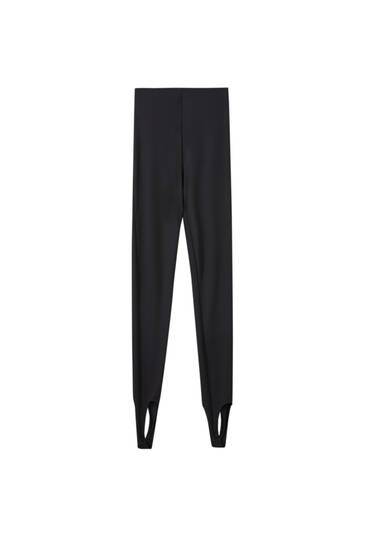 Black leggings with tape at the hem
