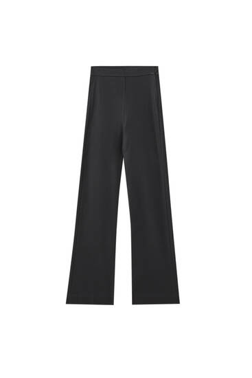 Coated kick flare trousers