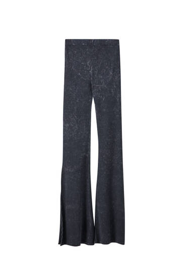 Faded black flared trousers