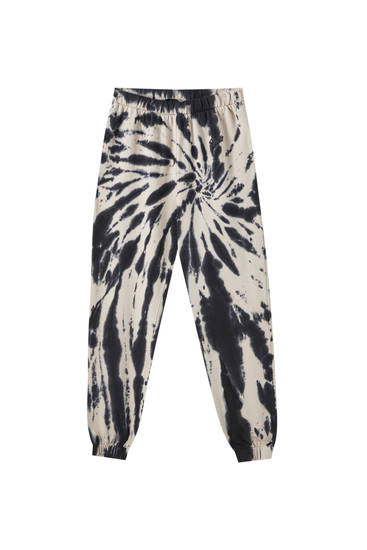 Trousers with tie-dye spiral