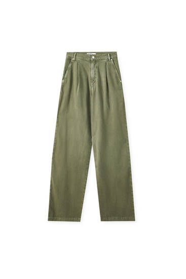 High-waist darted green jeans