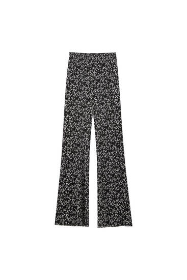 Flared pleated fabric trousers