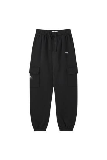 Broderede, sorte STWD-bukser
