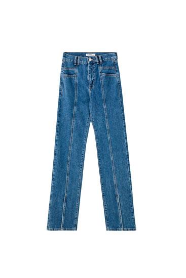 Jeans à boca de sino com aberturas