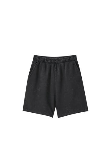 Faded black shorts with elastic waistband