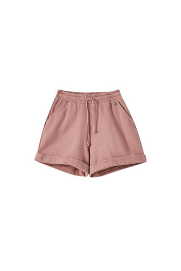 Pink jogging shorts with turn-up hems