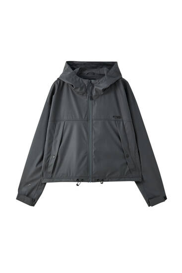 Short raincoat in technical fabric