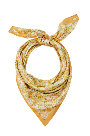 Yellow scarf with a floral print