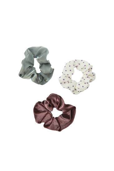 Pack of scrunchies in contrasting fabrics