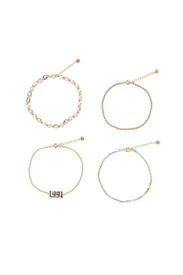 Pack of golden anklets with year