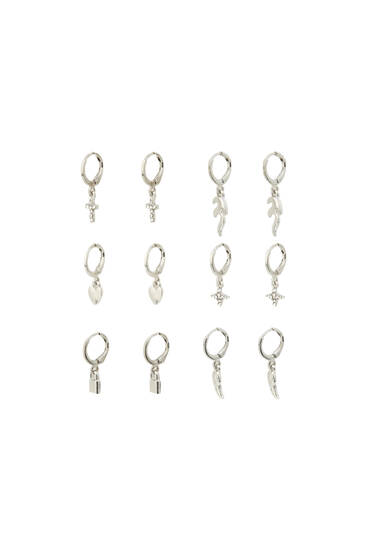 Pack of silver earrings with charms