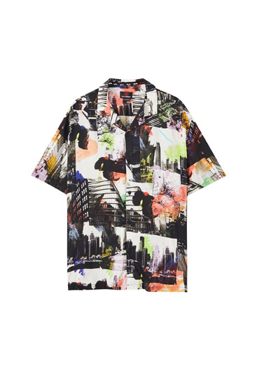 Shirt with a spray print of cities