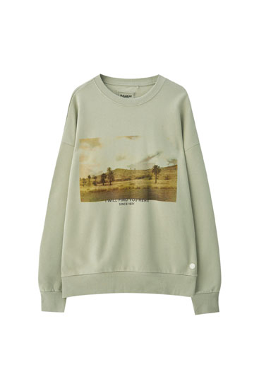 Sweatshirt with a landscape illustration