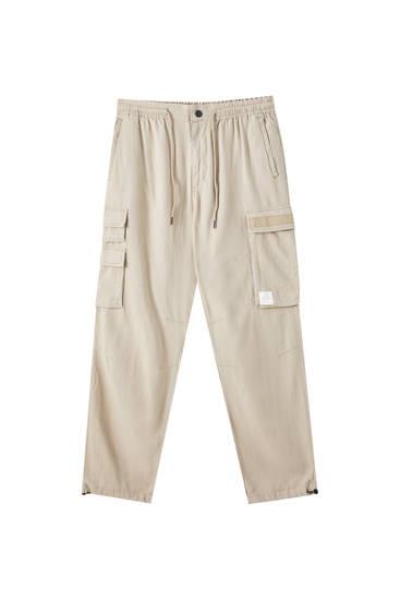Pantalón slim fit lino