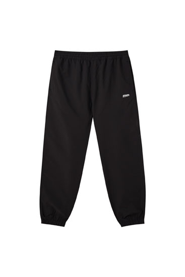 Nylon jogging trousers with logo detail