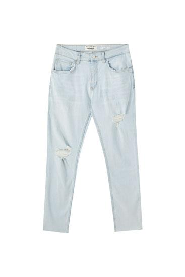 Úzké džíny premium s roztrháním na nohavici
