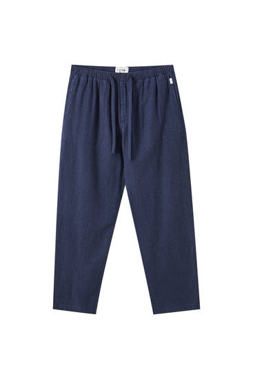 Blue linen trousers with an elastic waistband