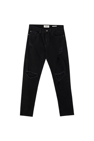Black super skinny jeans with rip details