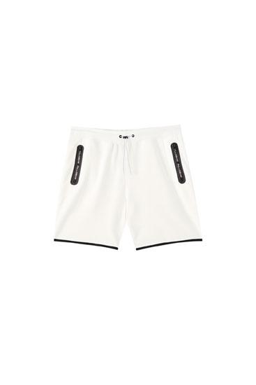 Basic-Bermudashorts im Jogger-Stil mit Taschen und Reißverschluss